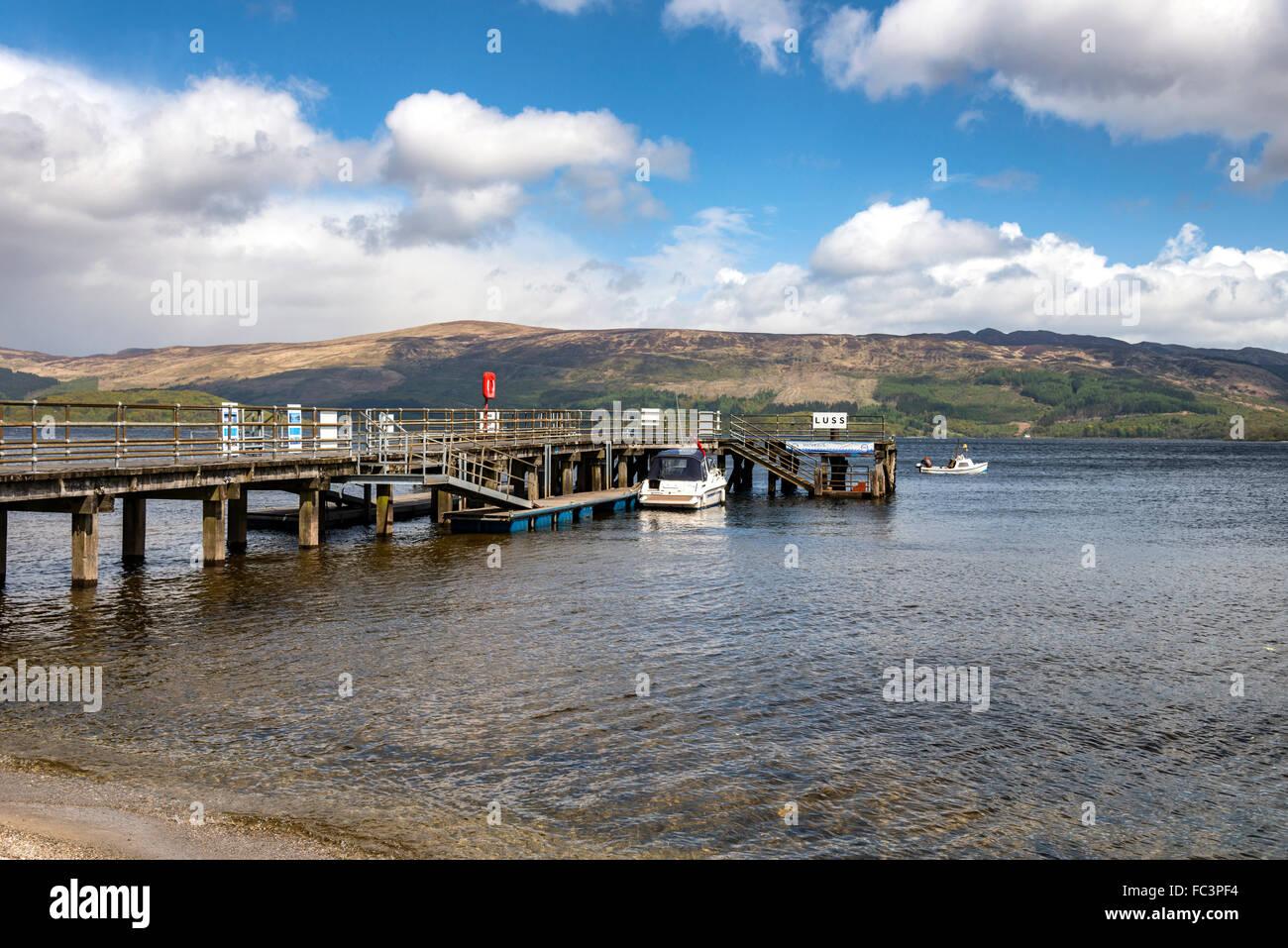 Luss pier on the banks of Loch Lomond - Stock Image