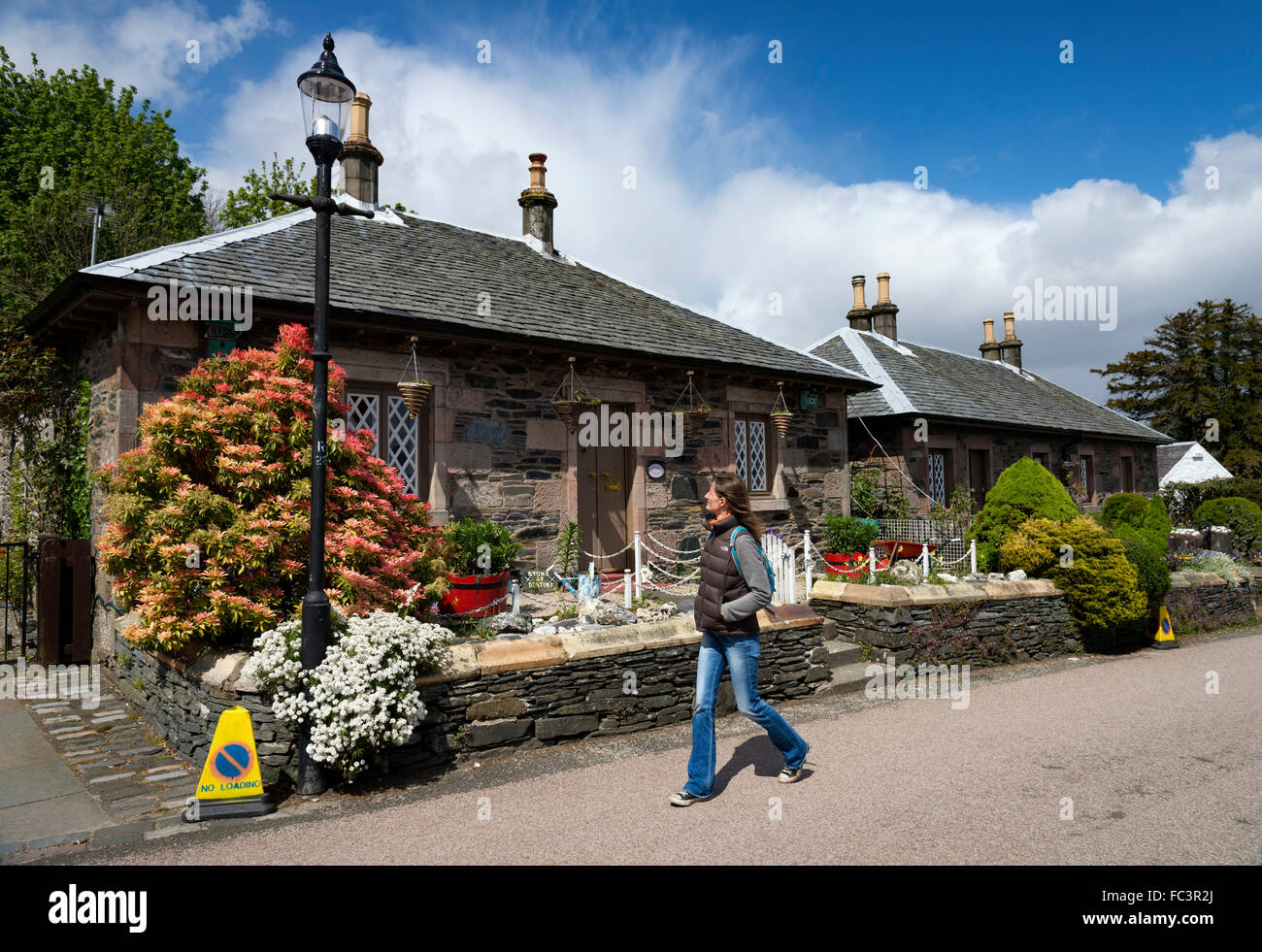 The pretty main street in Luss village on the banks of Loch Lomond - Stock Image