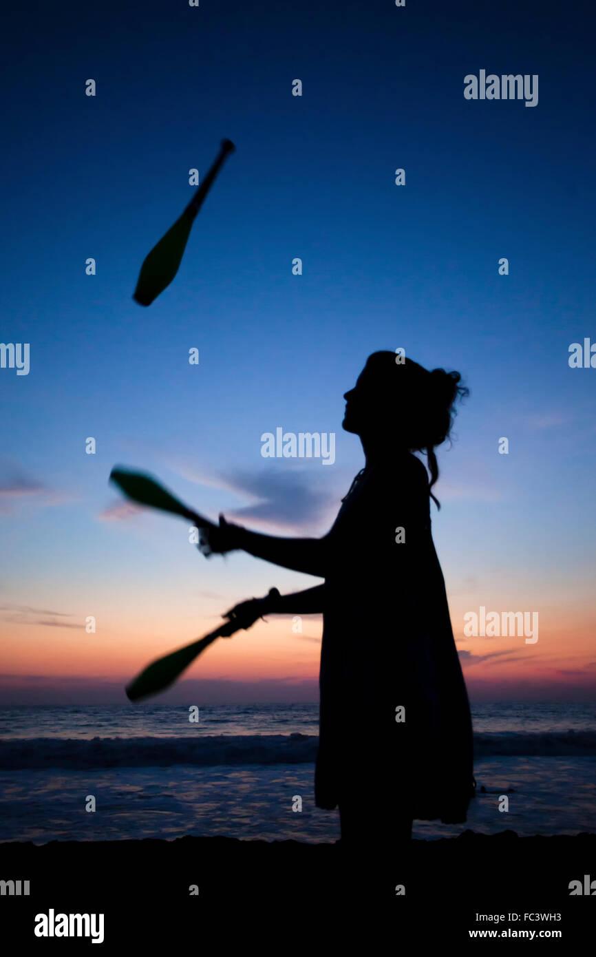Keila juggling on La Punta beach in Puerto Escondido, Oaxaca, Mexico. - Stock Image