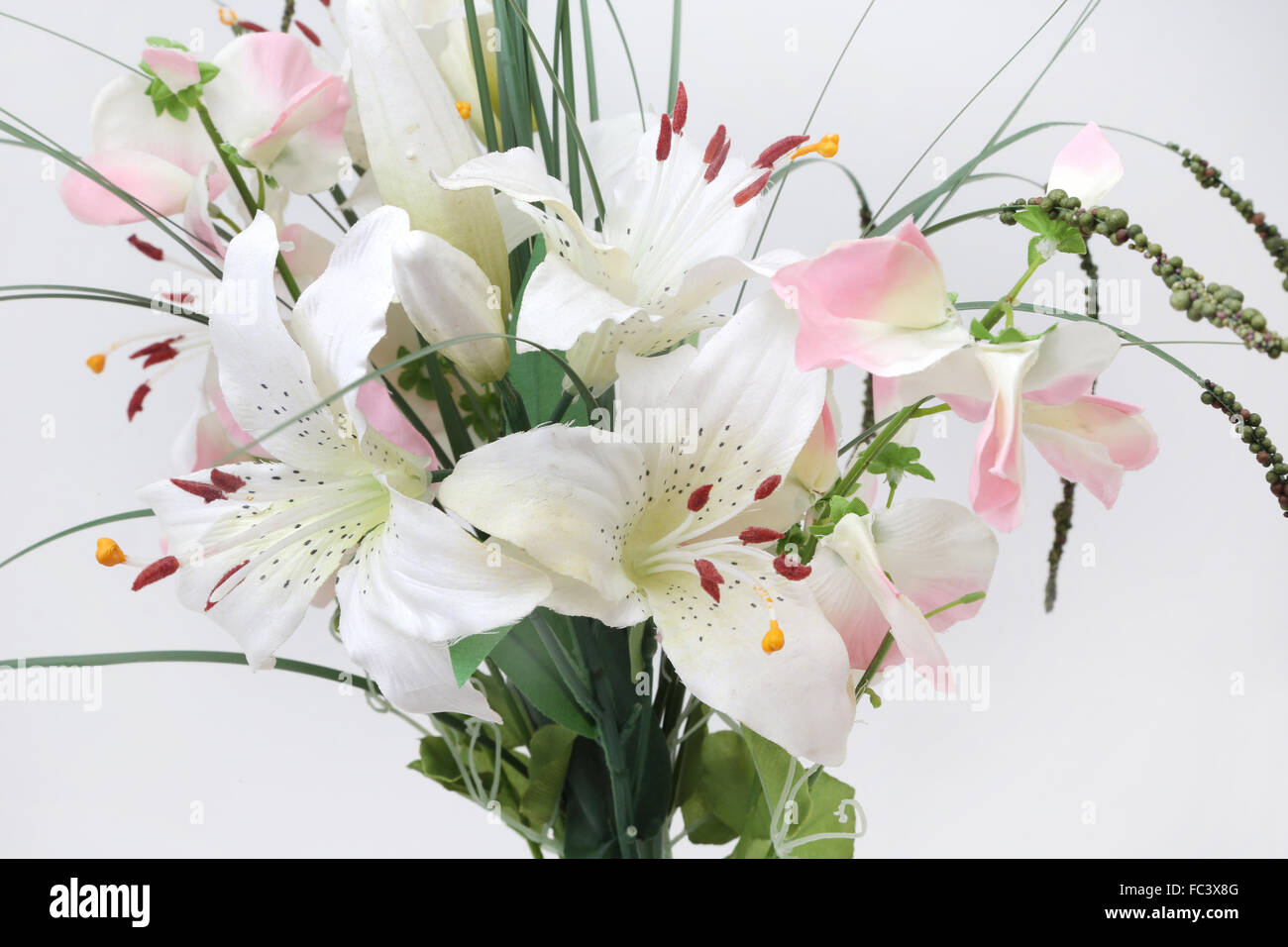 A bouquet of fabric flowers fake lillies stock photo 93514192 alamy a bouquet of fabric flowers fake lillies izmirmasajfo