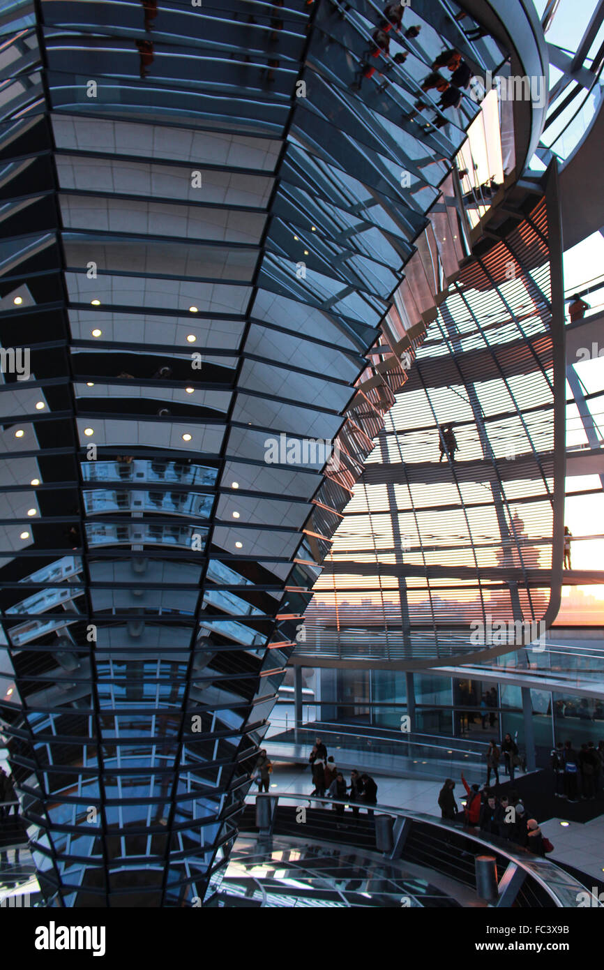 Germany Berlin Reichstag Parliament Interior of Glass Dome  design by Norman Foster  during sunset - Stock Image
