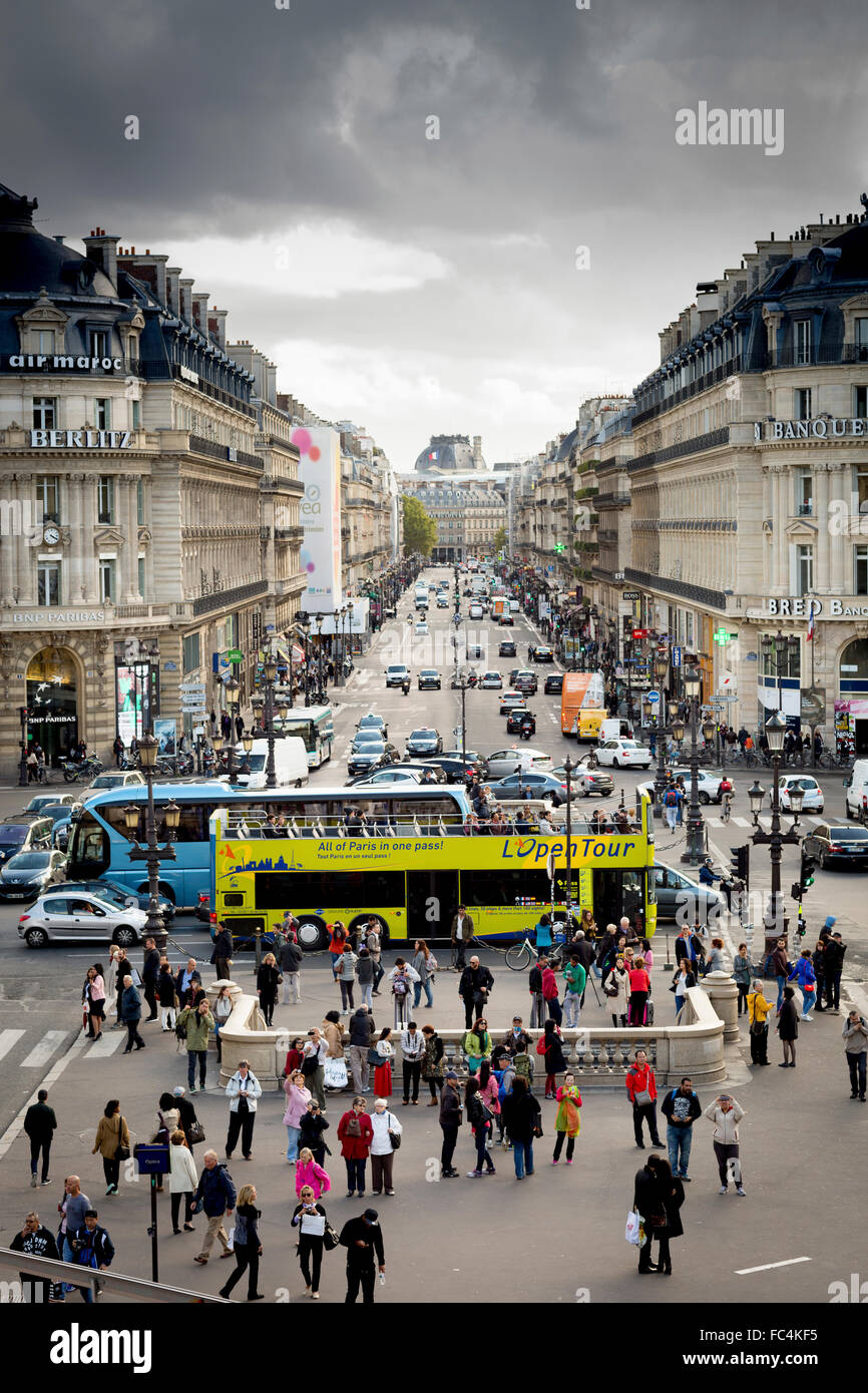 Storm clouds shadow a Parisian Boulevard from the Place de L'Opera. - Stock Image