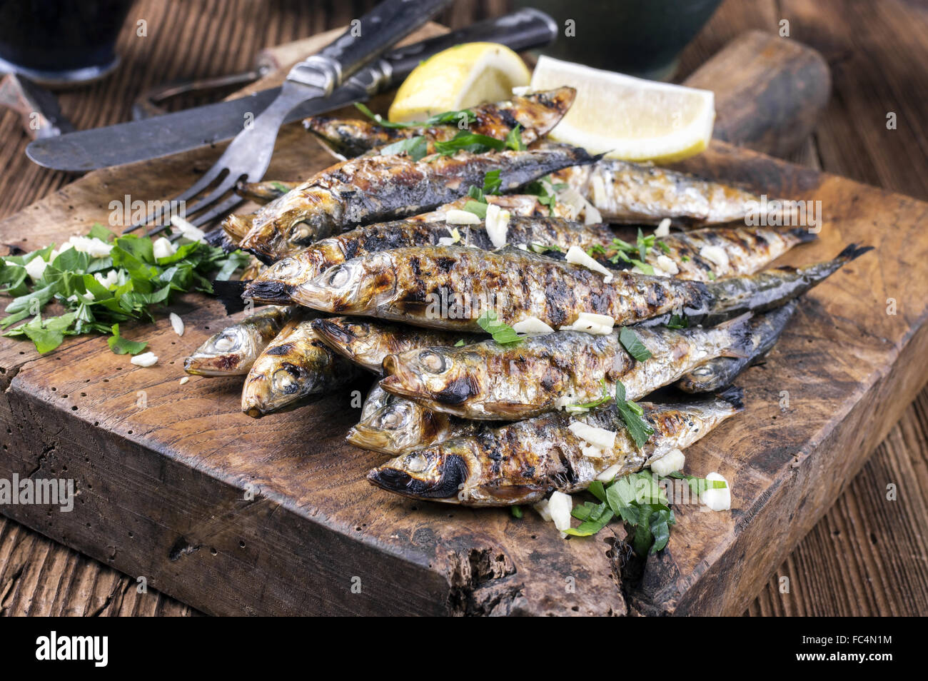 Grilled Anchovies - Stock Image