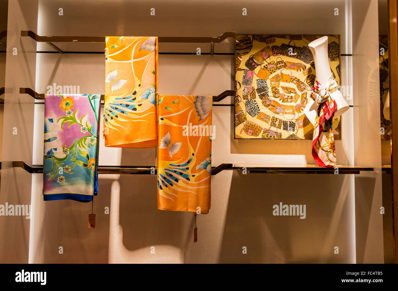 Silk scarves for sale at Wensli Silk Museum in Hangzhou, China, where people can buy a Marc Rosier scarf for $450 - Stock Image