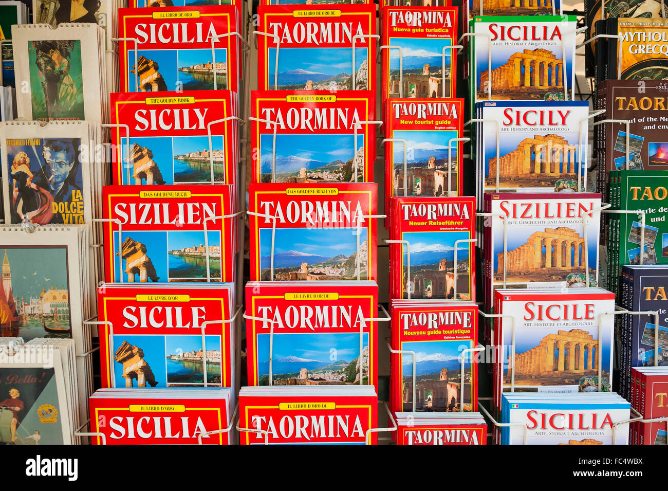 Guide book Sicily, view of a display of guide books in different languages in a street in Taormina, Sicily. - Stock Image