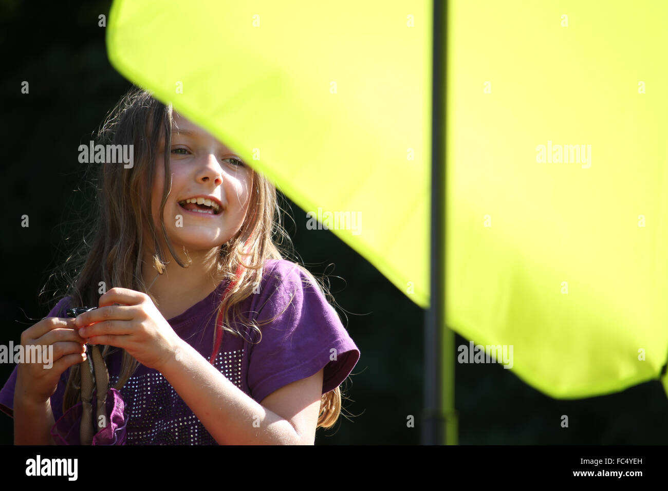child and parasol - Stock Image