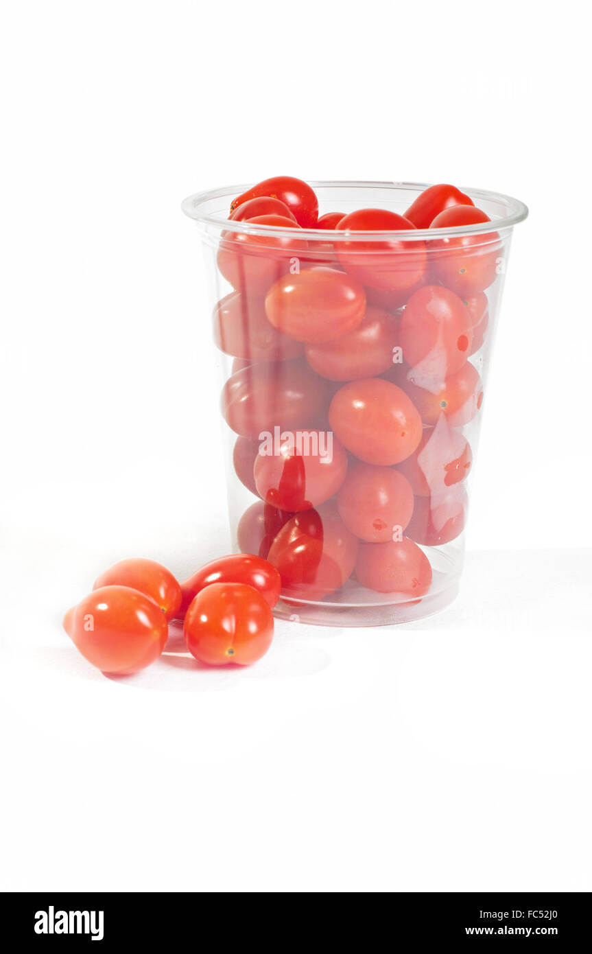 Red cherry tomatoes in plastic packaging - Stock Image