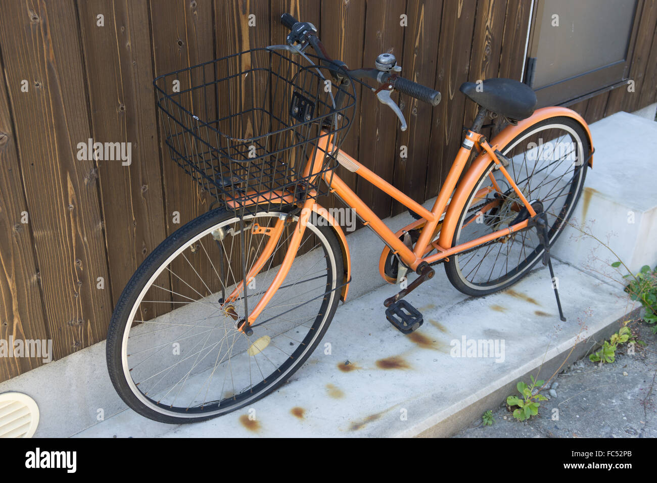 abandoned bicycle in Japan - Stock Image