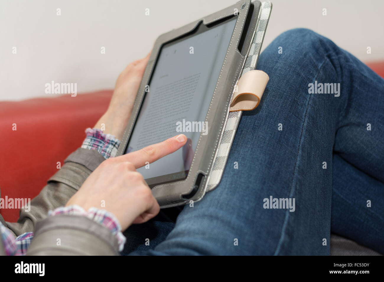 Tablet as an ebook in use - Stock Image