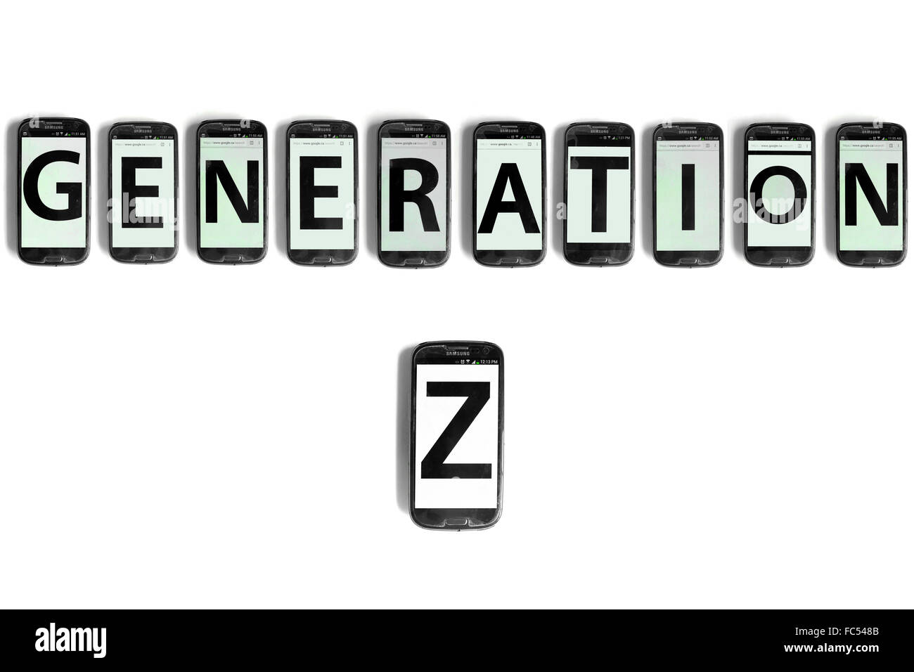 Generation Z written on the screens of smartphones photographed against a white background. - Stock Image