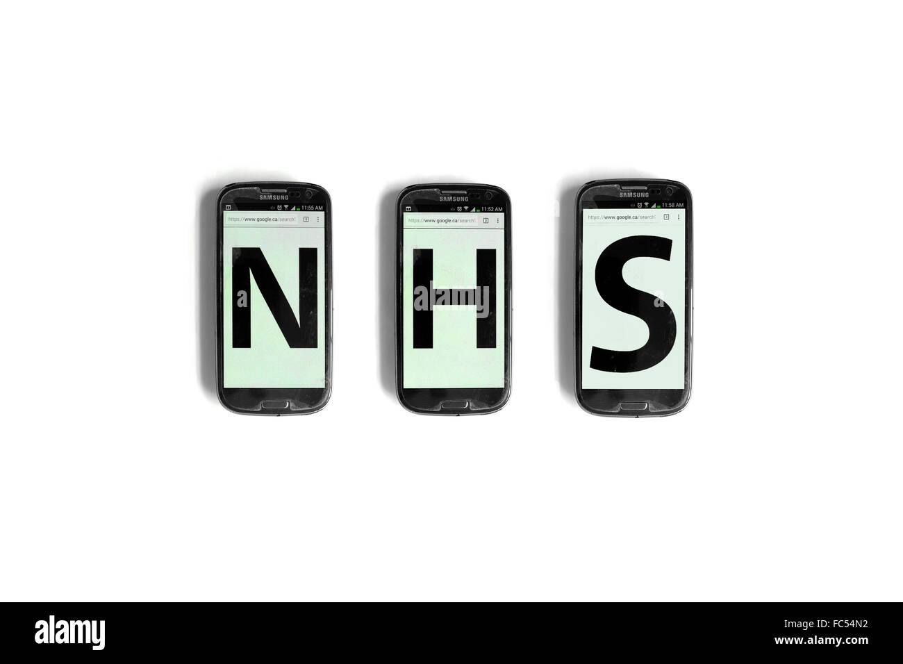 NHS written on the screen of smartphones photographed against a white background. - Stock Image