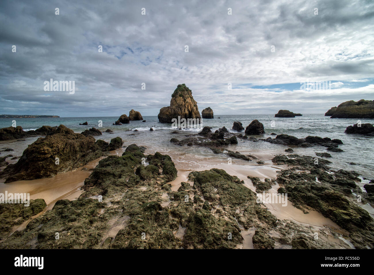 Rocky shoreline at Praia do Vau in the Algarve Portugal - Stock Image