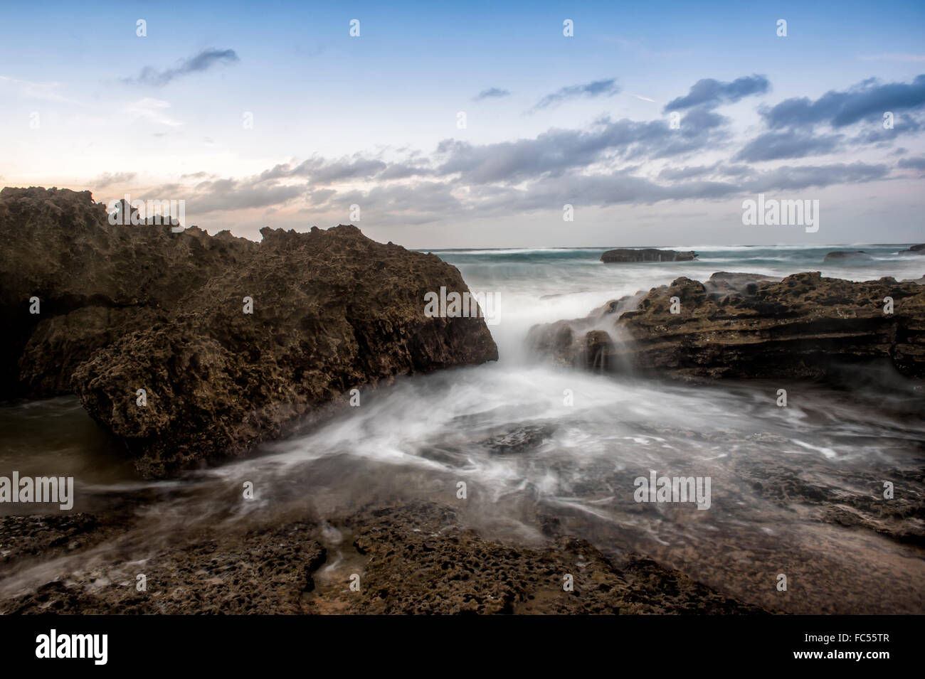 waves on the rocks at Praia do Castelejo Stock Photo