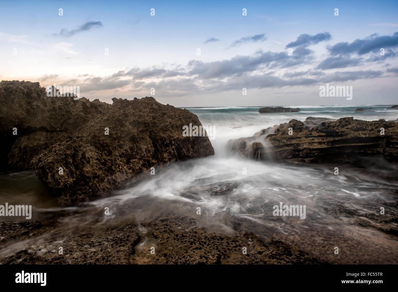 waves on the rocks at Praia do Castelejo - Stock Image