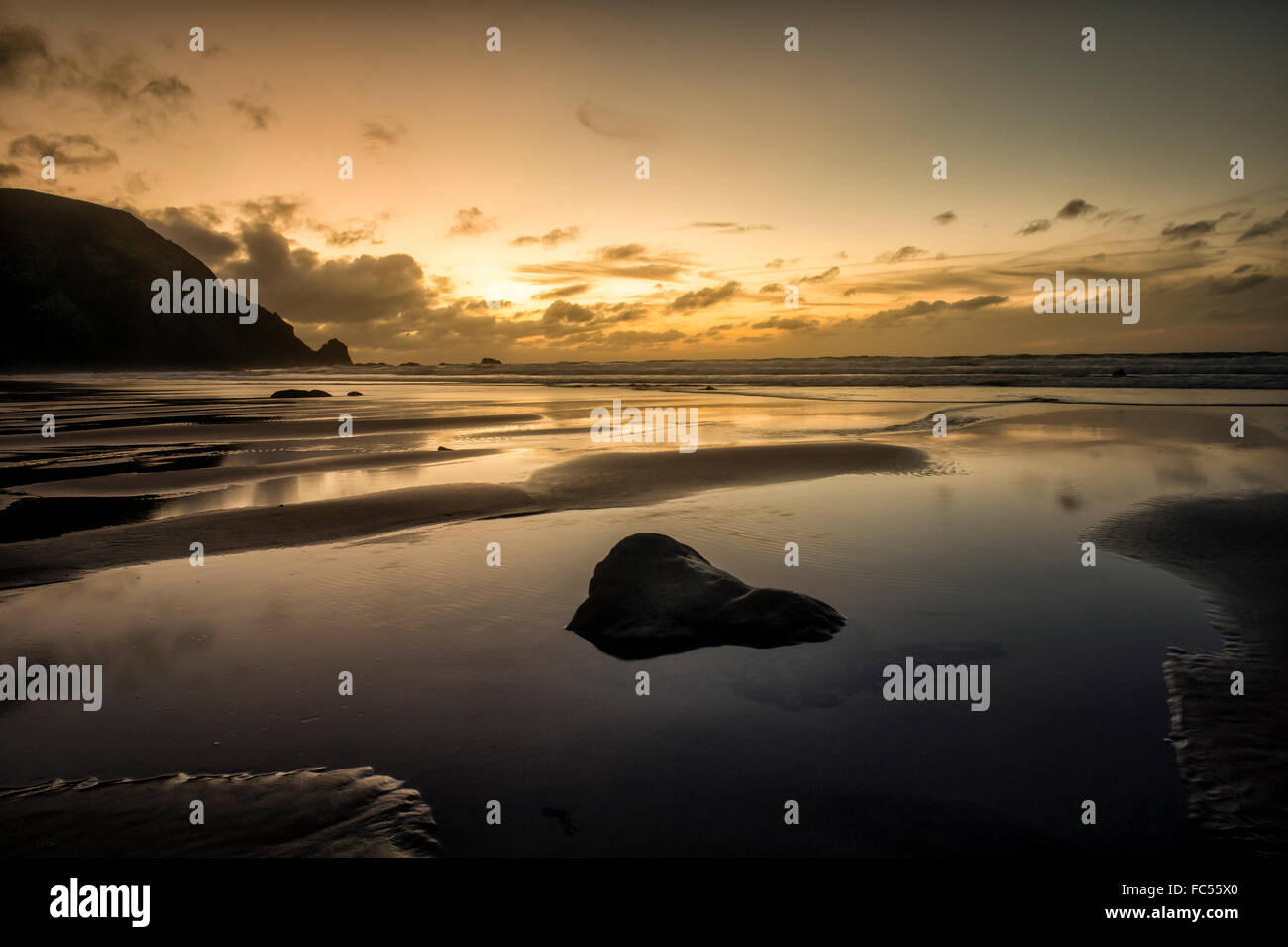 Sunset at Praia do Castelejo in the western Algarve, Portugal. - Stock Image
