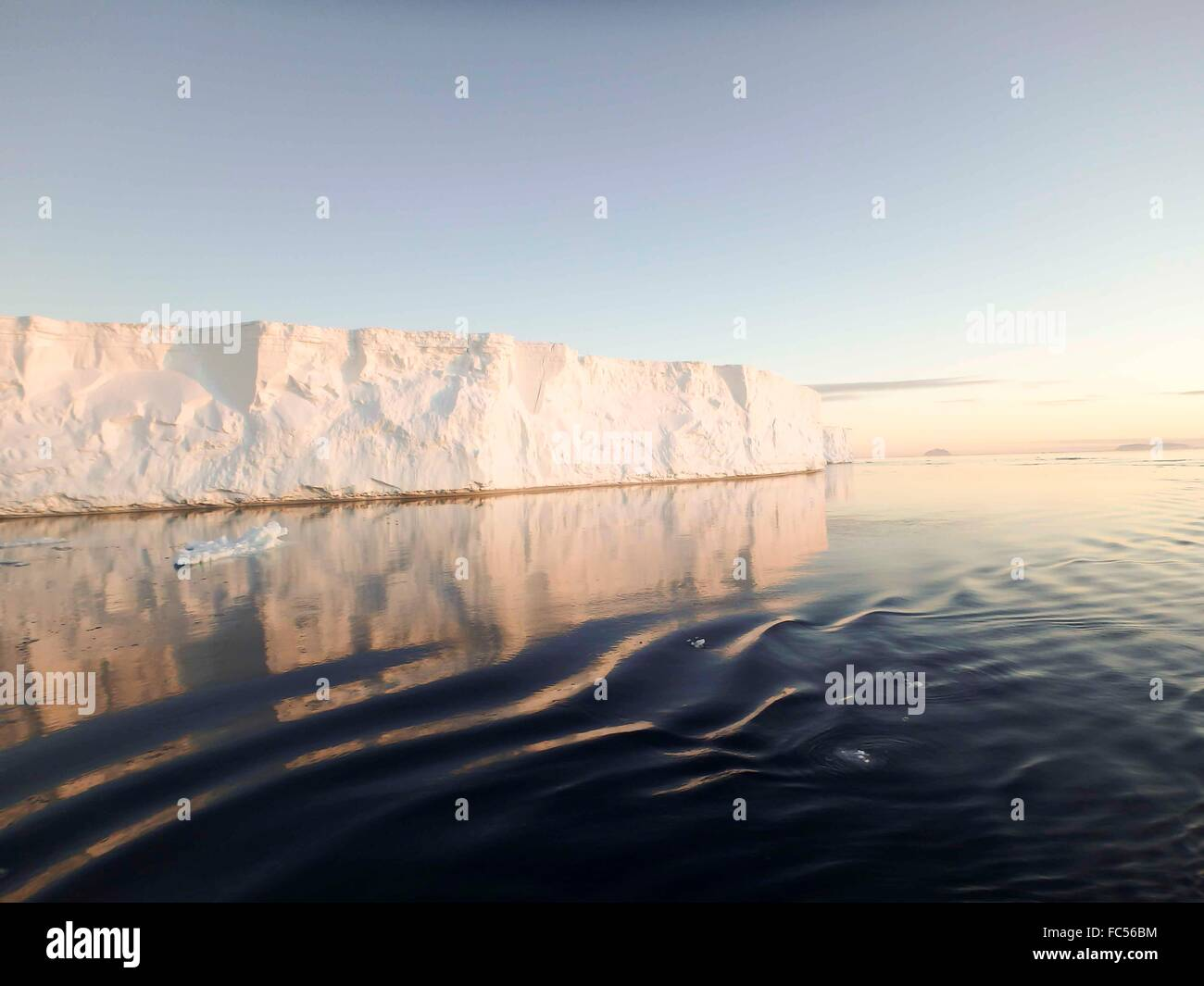 Huge tabular icebergs in Antarctic Sound at twilight in summer. Stock Photo