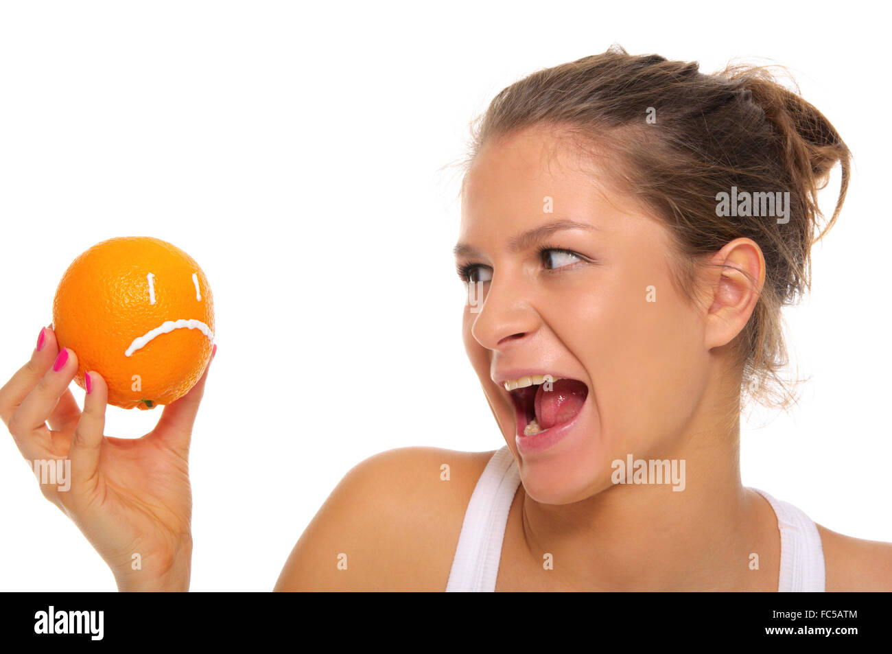 Woman holds orange with insult - Stock Image