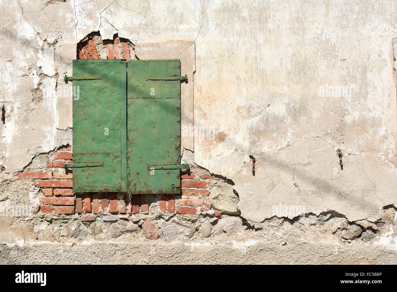 shutter on an old house in Slovenia - Stock Image