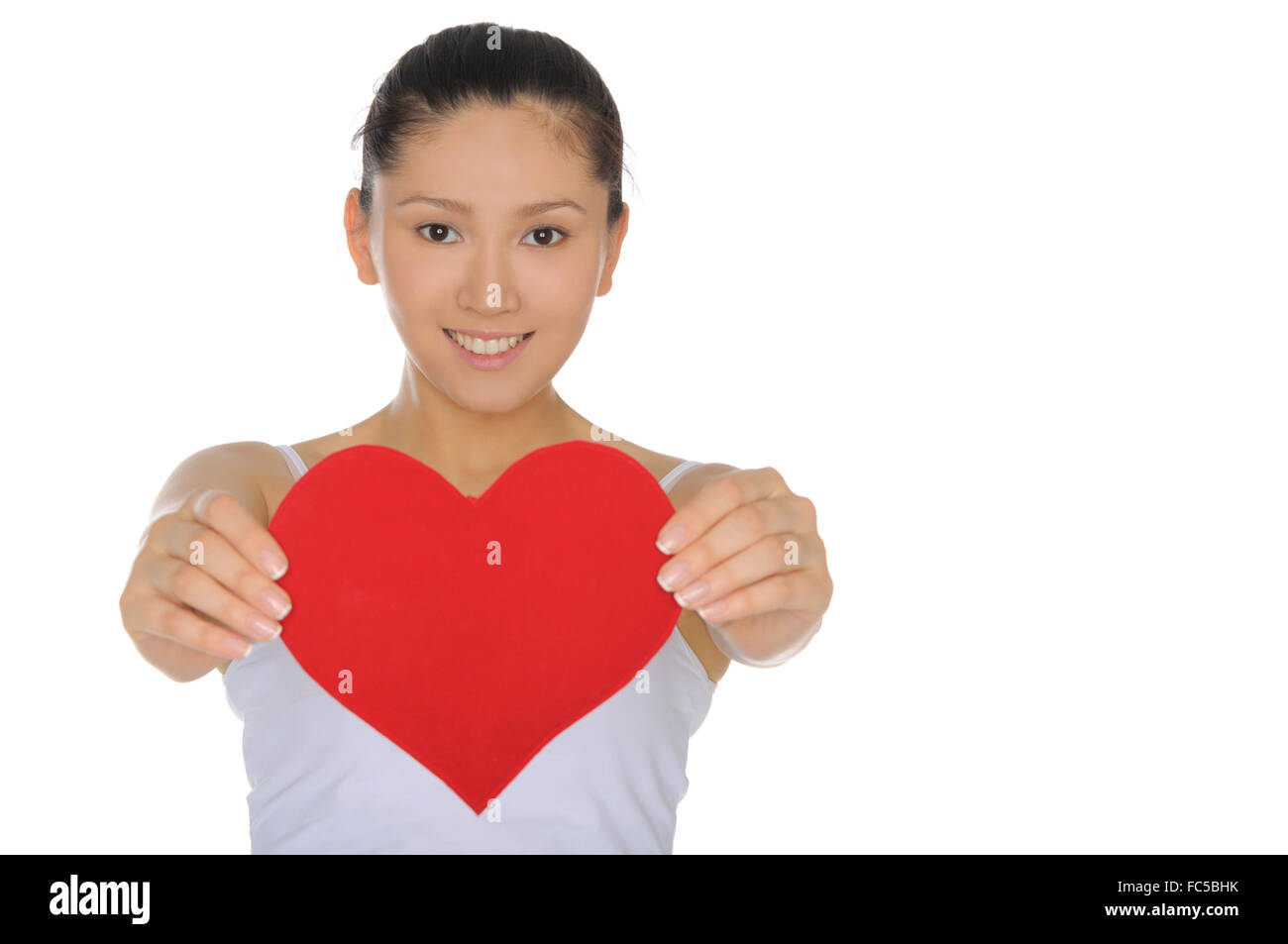 beautiful Asian woman holds out the heart - Stock Image