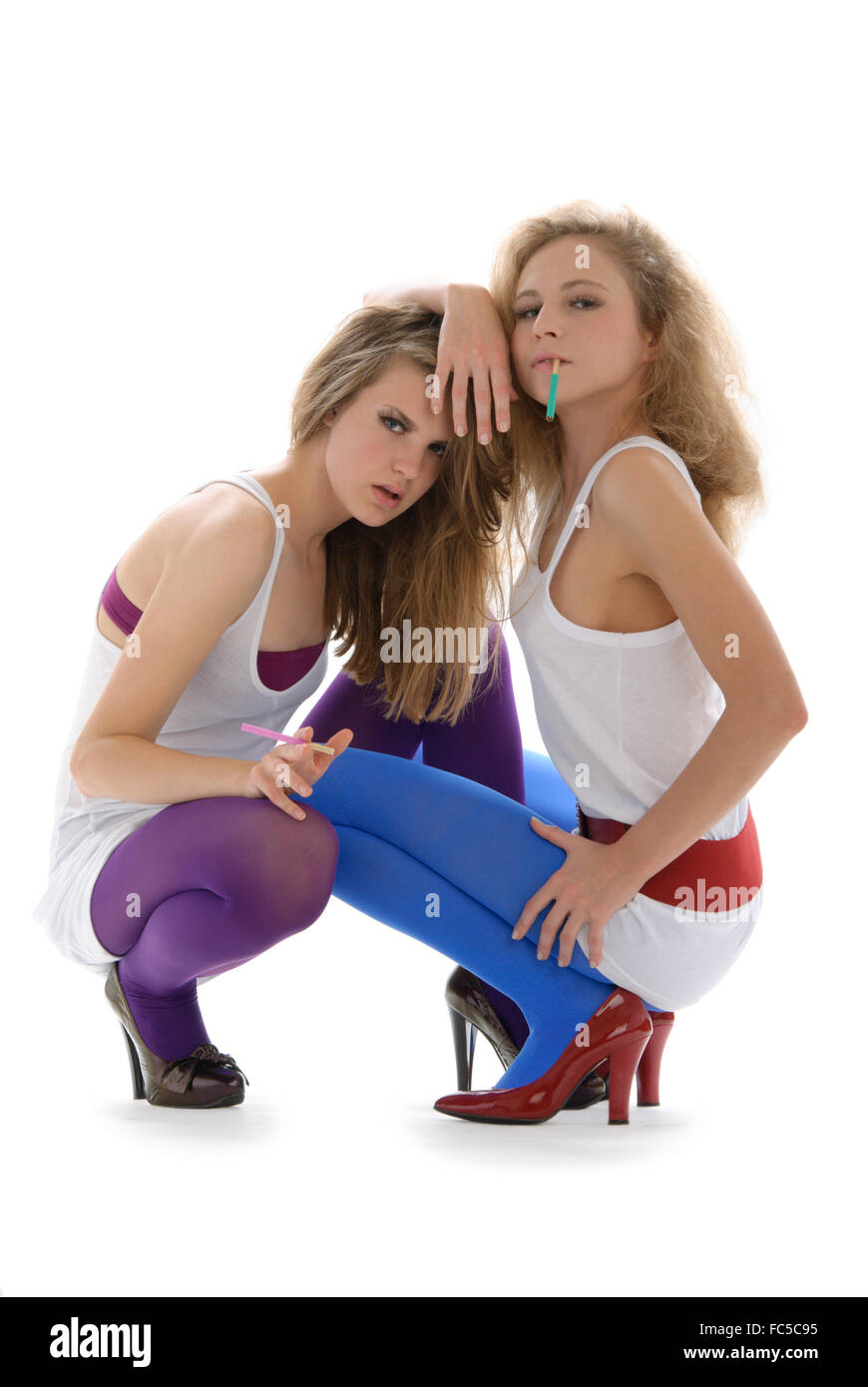Two young beautiful women with cigarettes - Stock Image