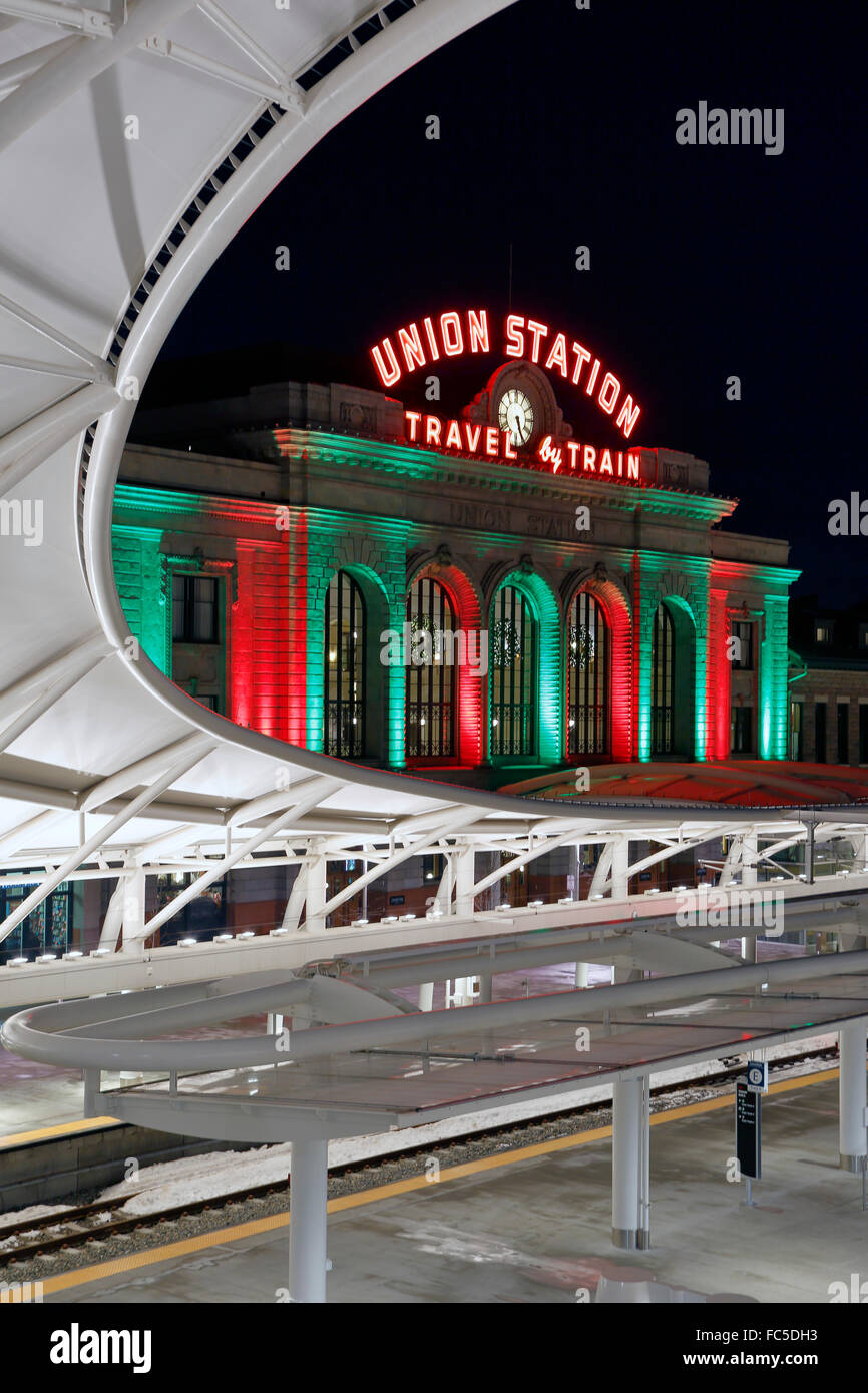 Train platform canopy and Union Station decorated with Christmas holiday lights, Denver, Colorado USA - Stock Image