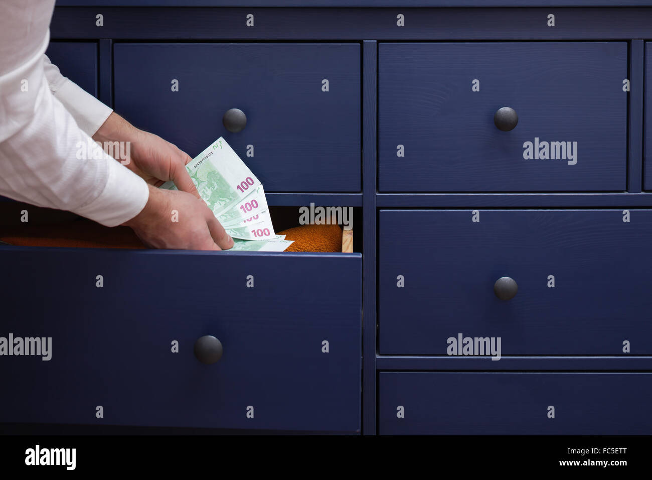 stash for a rainy day due to problems at work and in the economy - Stock Image