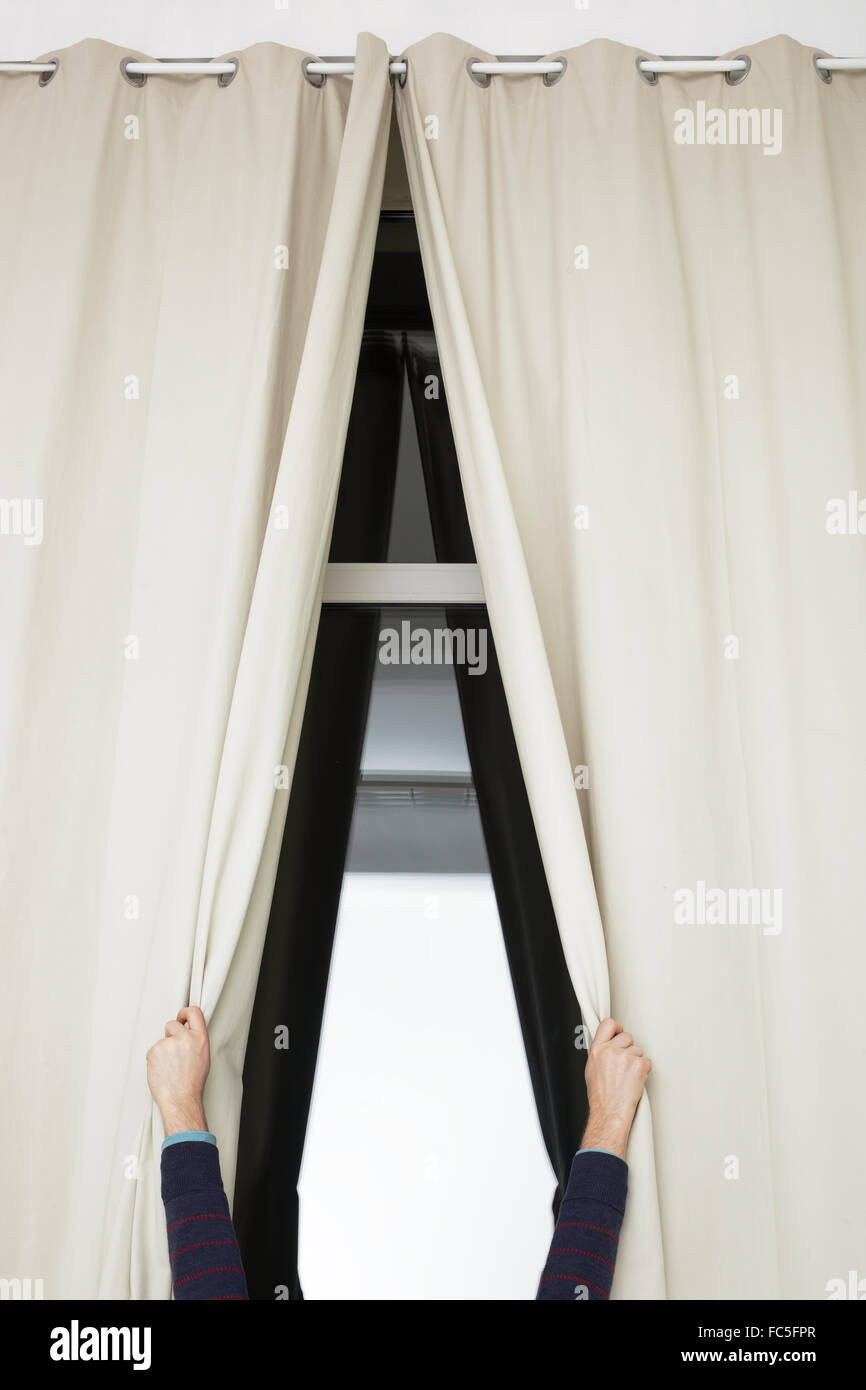 close long curtains in white room - Stock Image