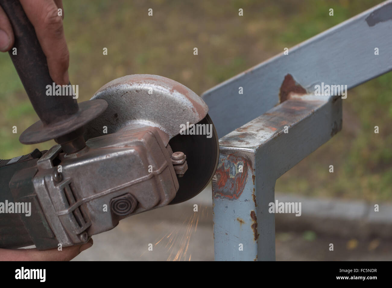 Metal is ground with angle grinder - Stock Image