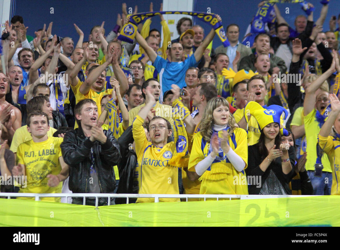FC BATE Borisov fans celebrate after scoring against FC Dynamo Kiev during their UEFA Europa League game - Stock Image