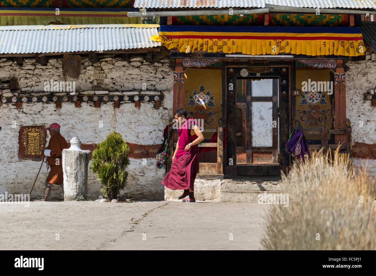 Monk at Tamshing Buddhist Temple, Jakar, Bumthang, Central Bhutan, Asia Stock Photo