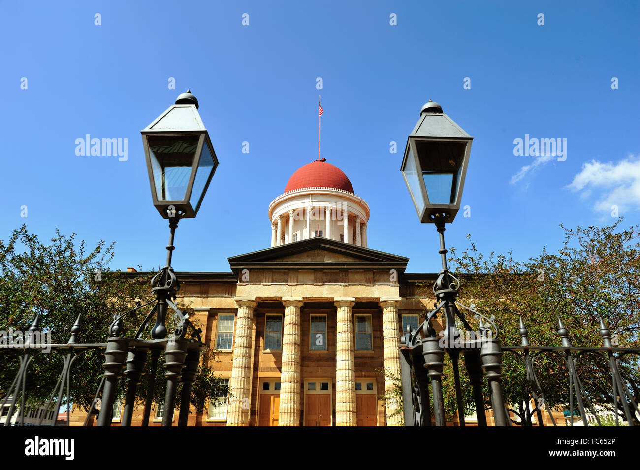 The Old State Capitol Building entrance and dome as seen past its entry gate and vintage lights in Springfield, - Stock Image