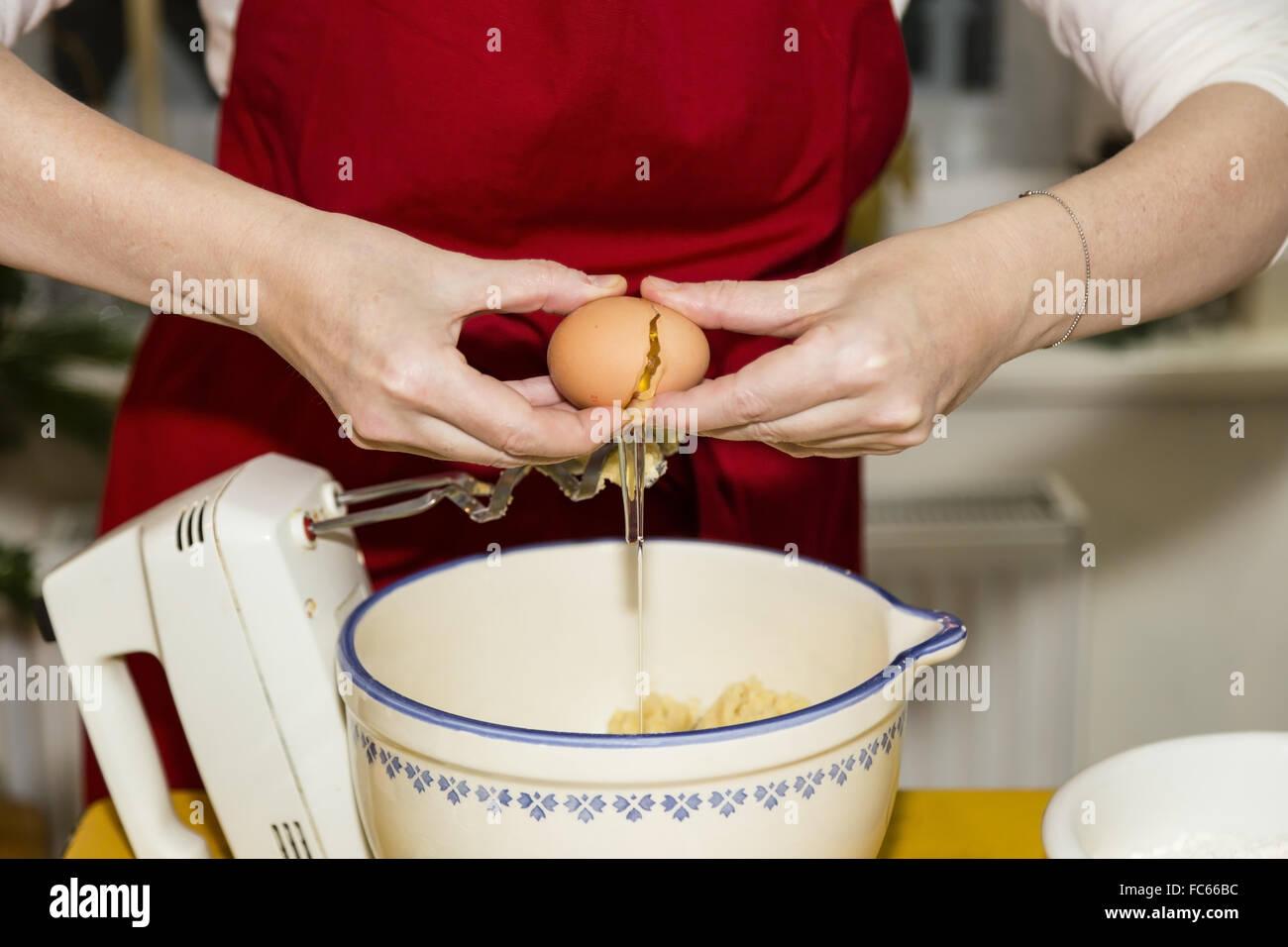crack an egg - Stock Image