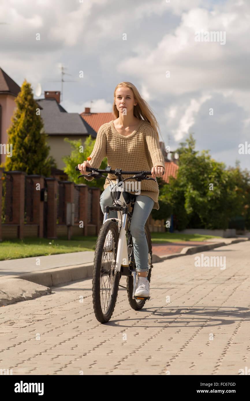 drives on bike - Stock Image
