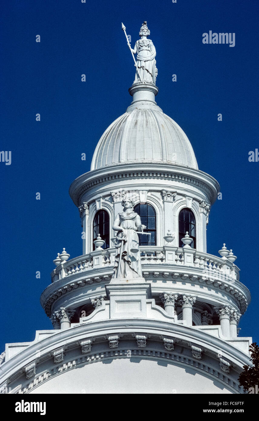 A statue of Minerva, the Roman Goddess of Wisdom, stands atop the cupola of the ornate Merced County Courthouse - Stock Image