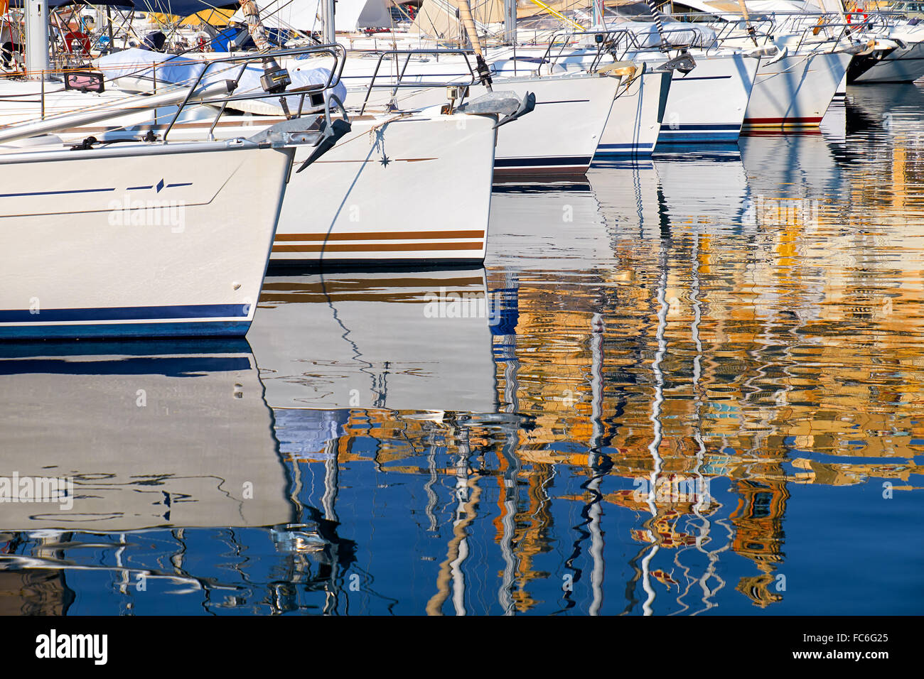 Reflection of yachts in water - Stock Image