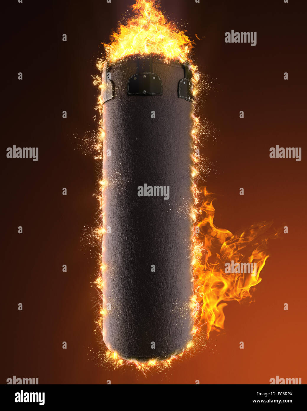 punching bag in fire - Stock Image