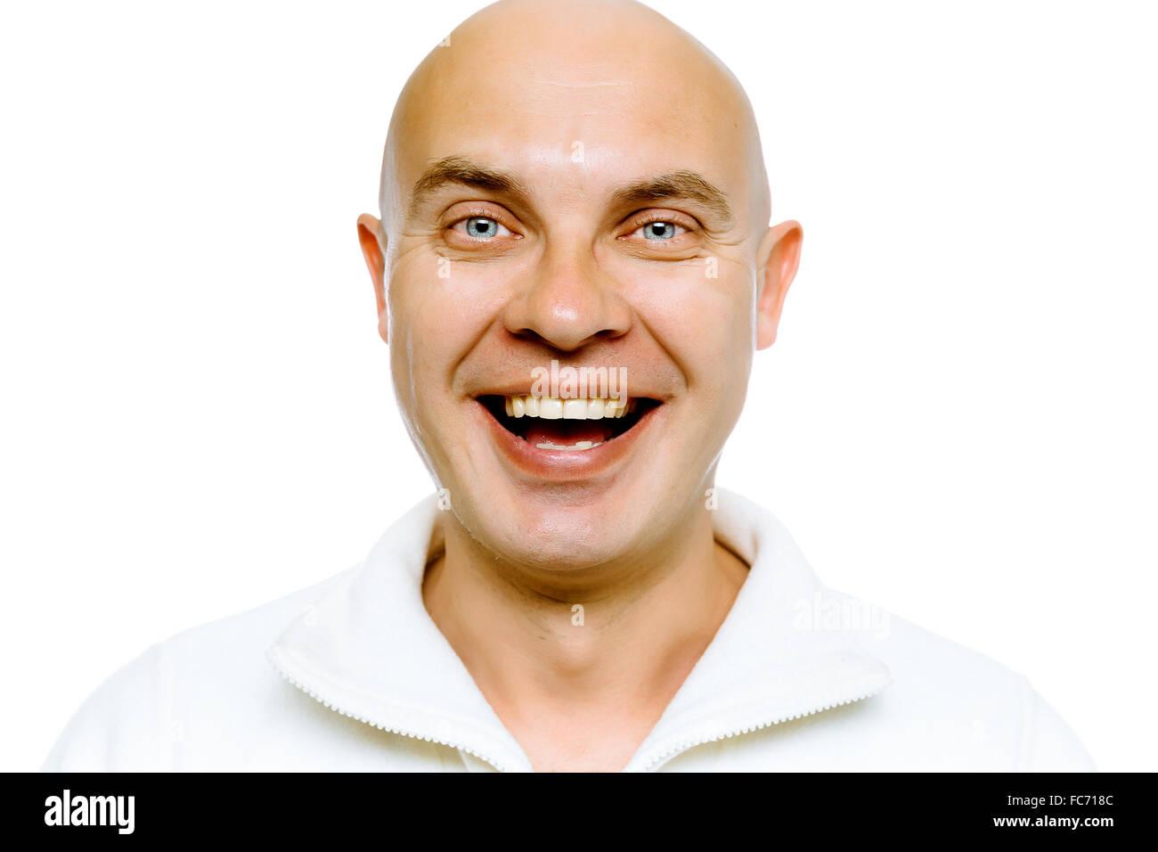 Bald smiling blue-eyed man. Studio. isolated - Stock Image