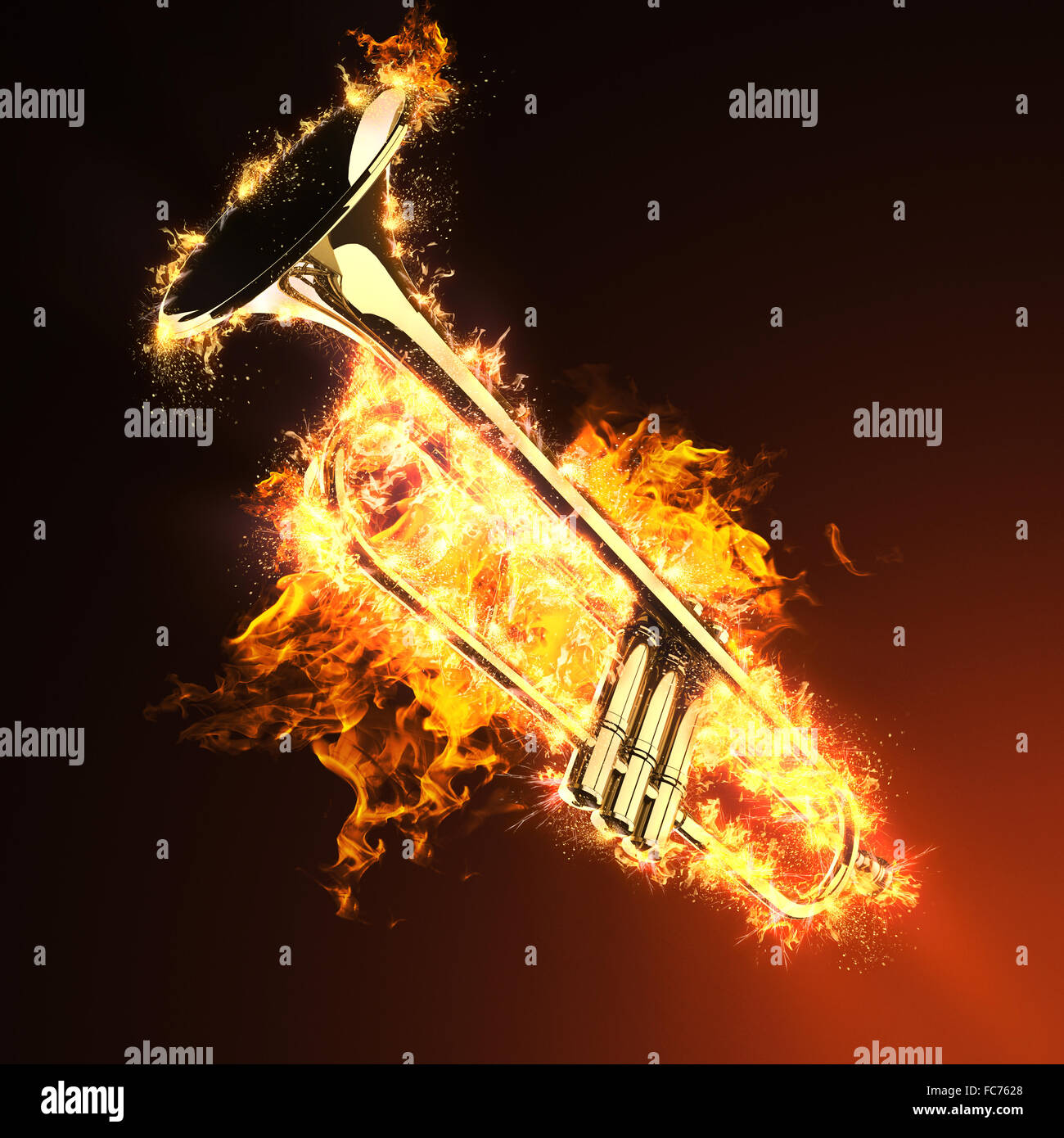 brass trumpet in fire - Stock Image