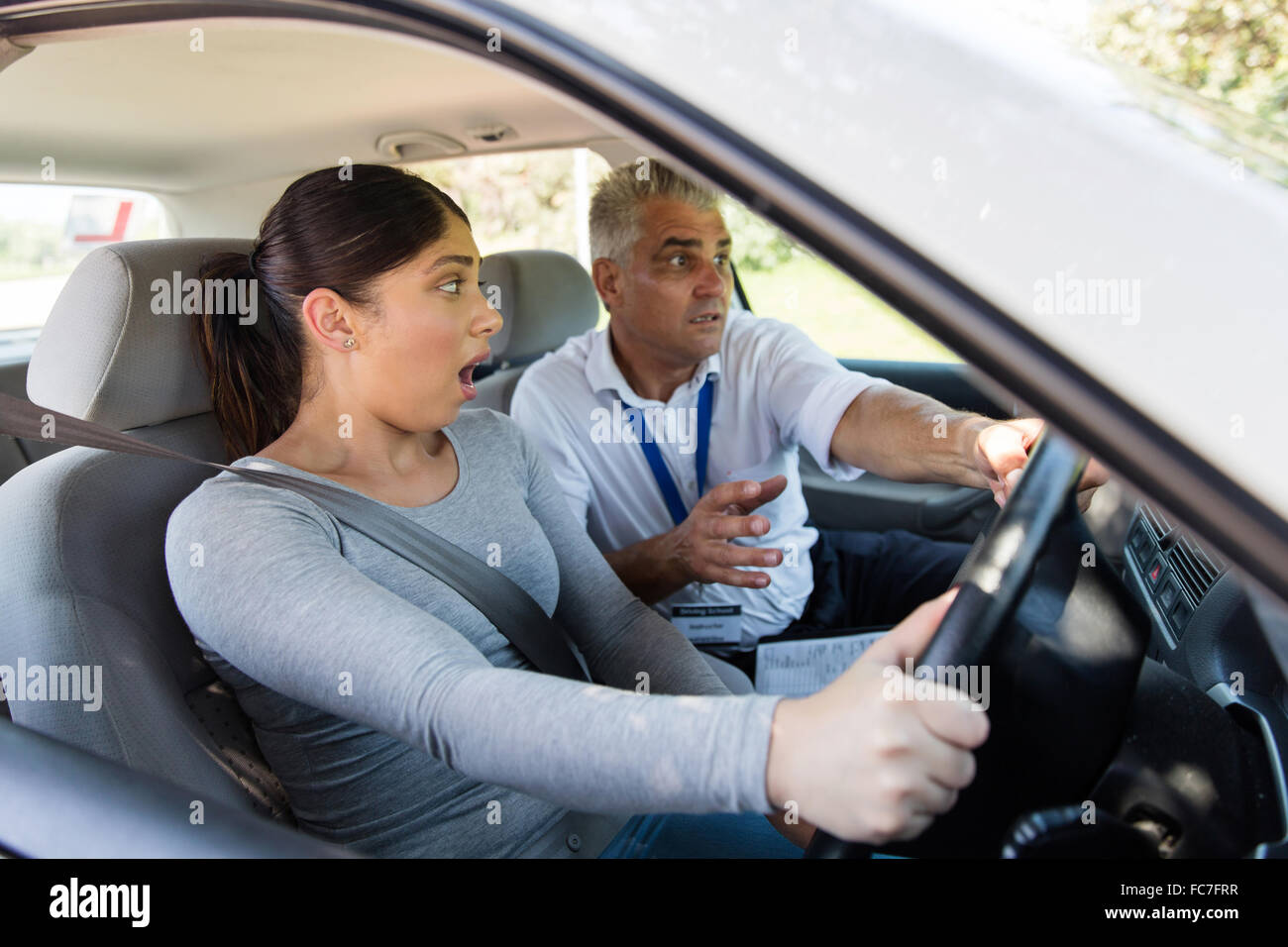 scared student driver making mistake during driving test - Stock Image