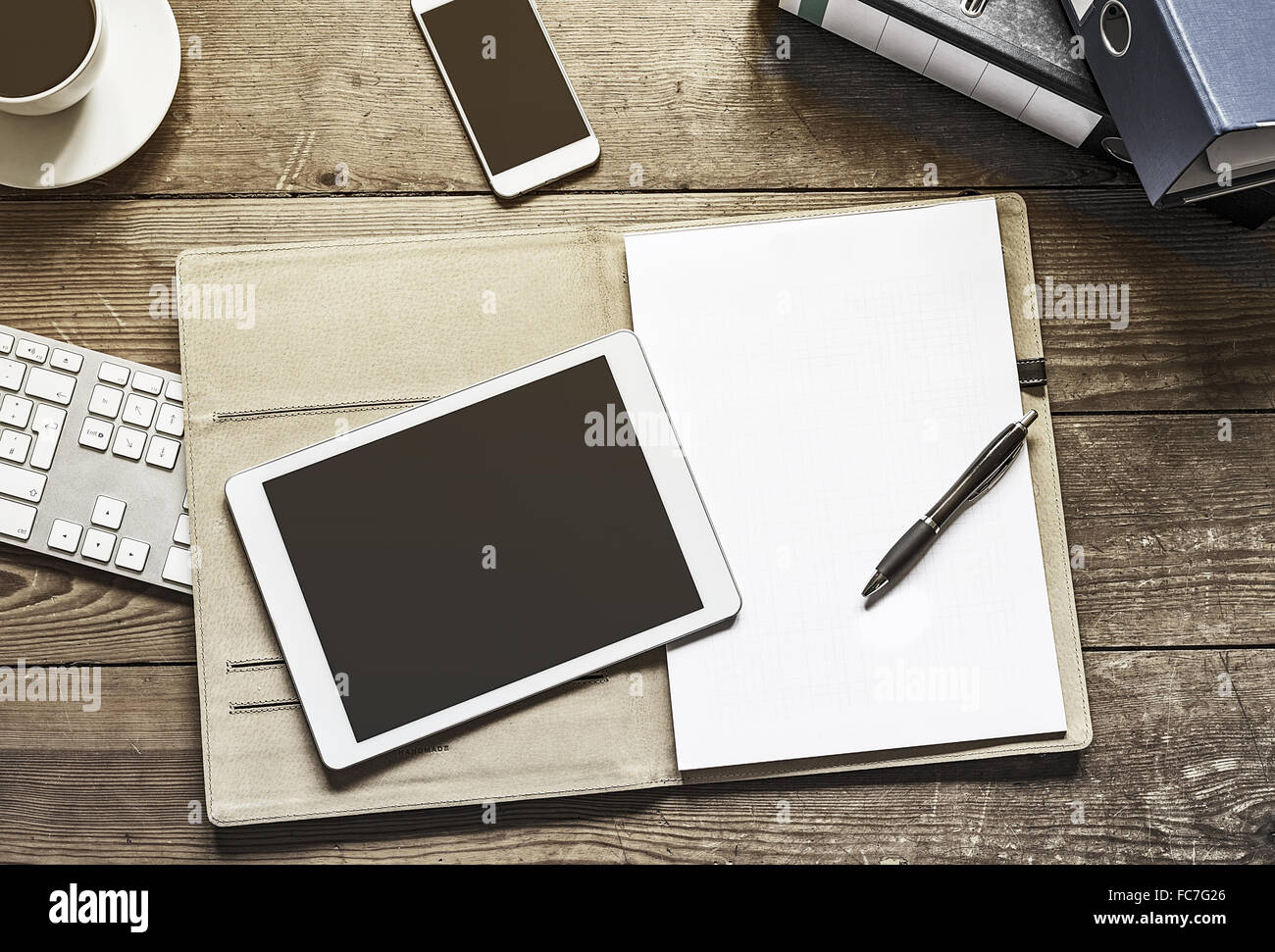 tablet and phone with folder - Stock Image