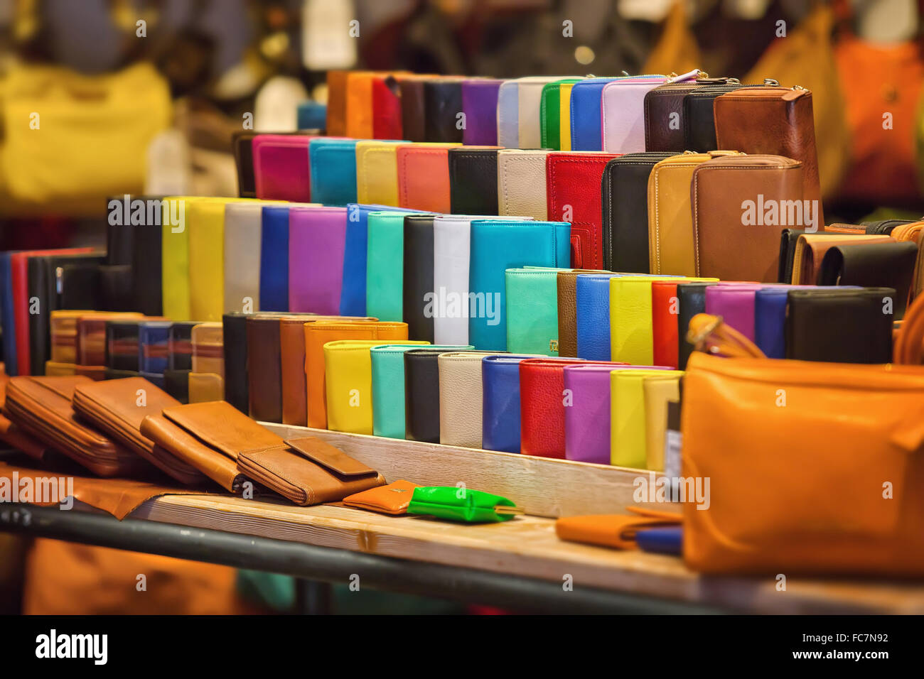 Many kinds of purses in different colors - Stock Image