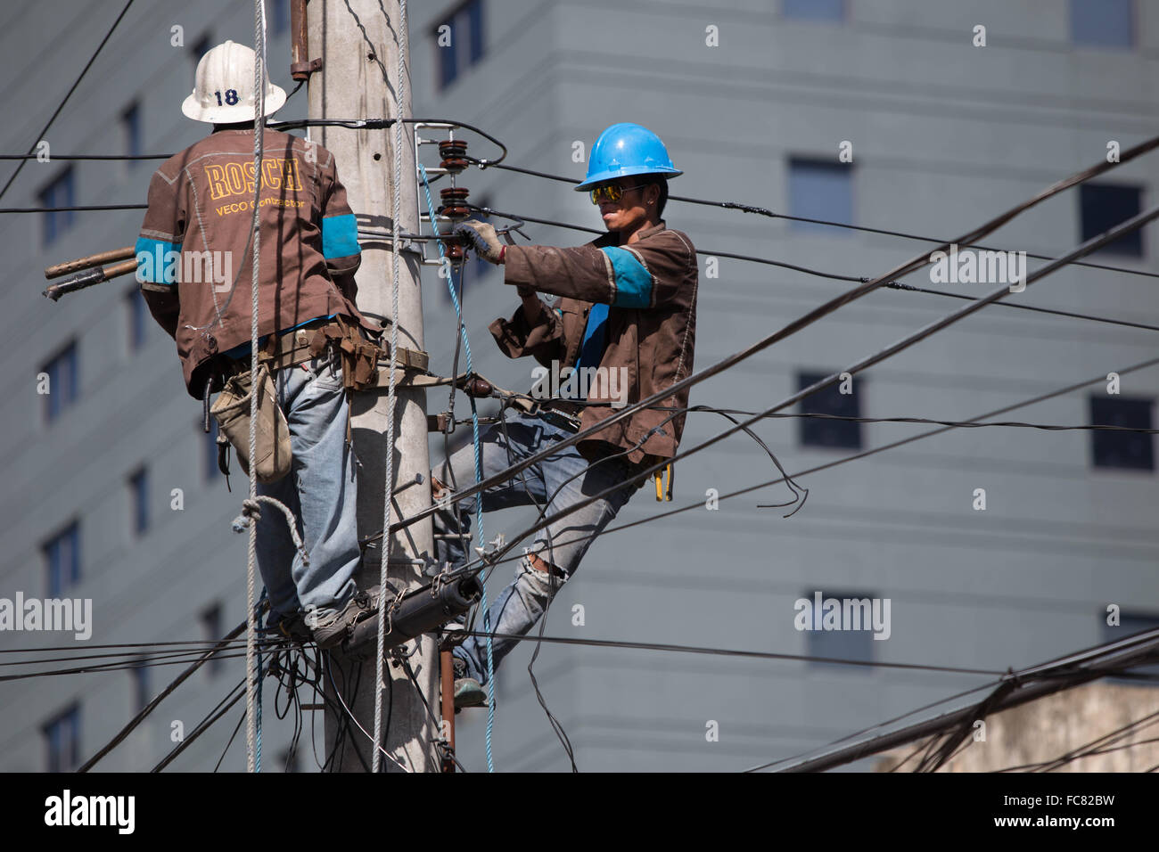 Cebu City,Philippines,Electricity Company employees working on overhead power lines. - Stock Image