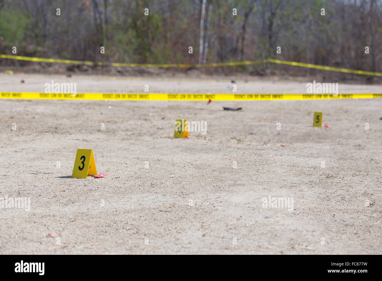yellow evidence number tag in car bomb crime scene - Stock Image