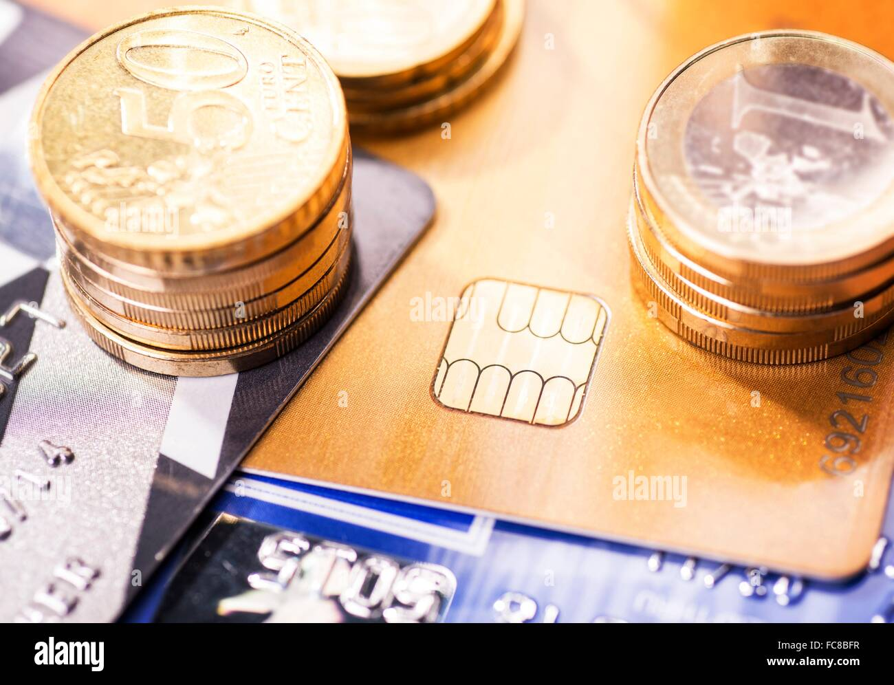 Smart card with chip and coins - Stock Image