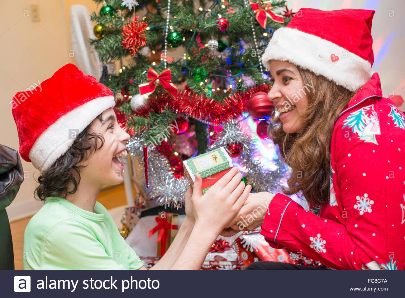 real life family celebrating christmas in their apartment hispanic christian family celebrates the religious holiday - Who Celebrates Christmas
