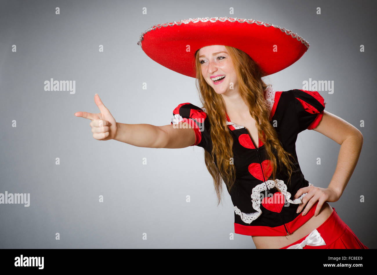 Mexican woman wearing sombrero hat Stock Photo  93614705 - Alamy 23bb5969ffb