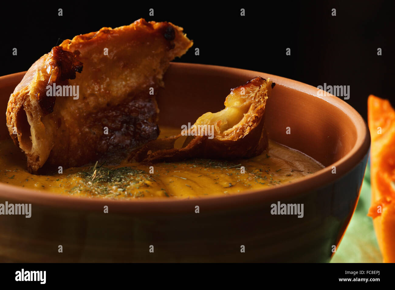 Pumpkin soup in darkness closeup - Stock Image