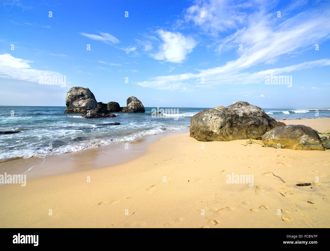 Big stones in the ocean and on a beach of Sri Lanka - Stock Image
