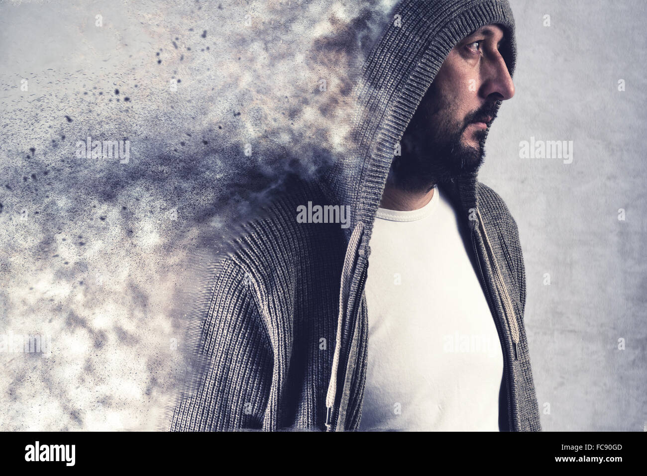 Adult bearded caucasain man dissolving under stress, conceptual image - Stock Image