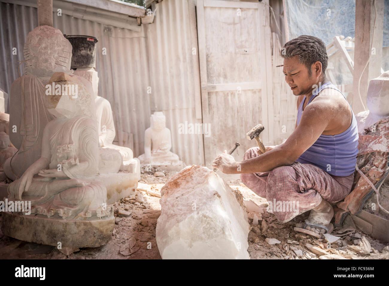 Starting to carve a Buddha image, Mandalay, Mandalay Region, Myanmar (Burma), Asia - Stock Image